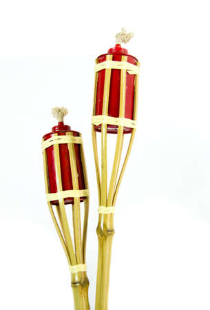 Two bamboo torches isolated on white background. Stock Photo