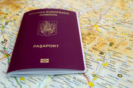 Biometric romanian passport placed on a map.