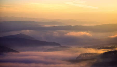 view over hills on a colorful misty morning in autumn  photo
