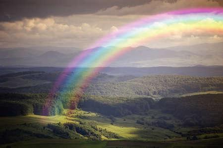 rainbow in a summer landscape photo