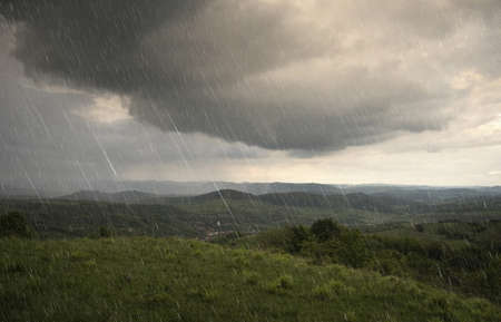 landscape with rain and dramatic clouds over hills  Stock Photo