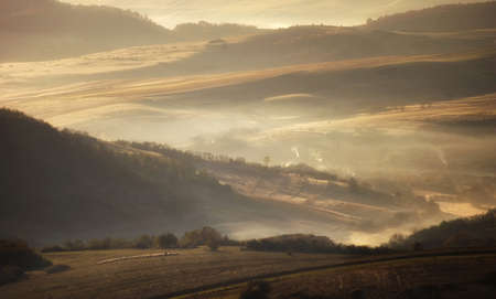 summer morning with fog between hills Stock Photo - 14124981
