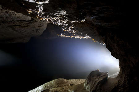 cave exploring: Light in a cave Stock Photo