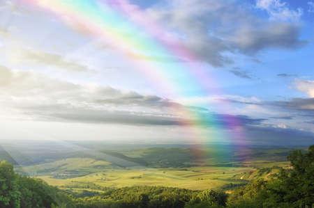 rainbow over spring landscape Stock Photo - 17204993