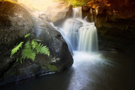 fantasy landscape: waterfall on mountain river