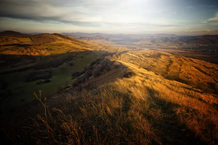 Beautiful autumn landscape with last rays of sun shining on hill Stock Photo - 17940461