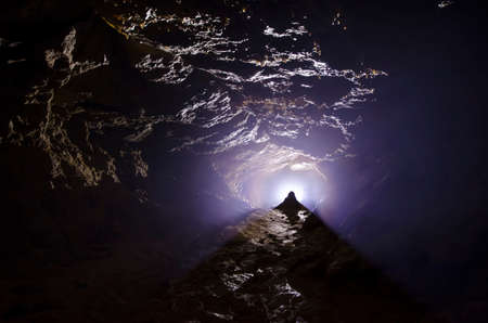 huge: Cave with light and fog underground