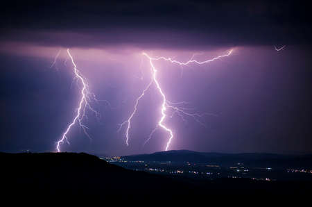 dark skies: Lightning storm night Stock Photo