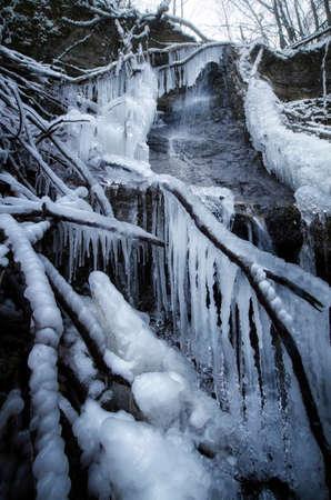 frozen winter: Frozen mountain waterfall in winter