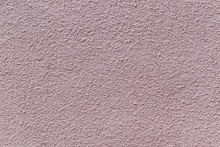 The wall is made of plaster and painted pink or beige paint. Prominent tubercles and pits, or pits. The wall is rough with small cracks. 版權商用圖片