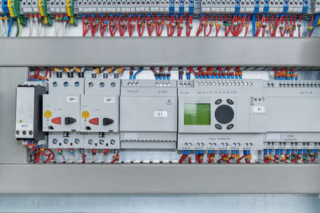 Relays, circuit breakers, motor protection and controllers extension modules. The number of bushing terminals. Electrical equipment connected by wires to a marking. Controller with LCD screen.