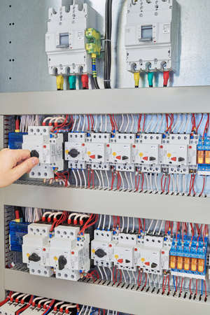 Man switch switch protection engine to check in the electrical Cabinet. In the electrical control Cabinet on a mounting plate fixed circuit-breakers, motor protection relay.