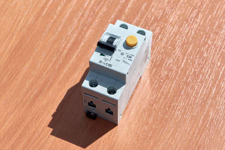 On the table there is an automatic switch of differential current. The device protects human life from electric shock. It combines an automatic switch plus a protective shutdown device.
