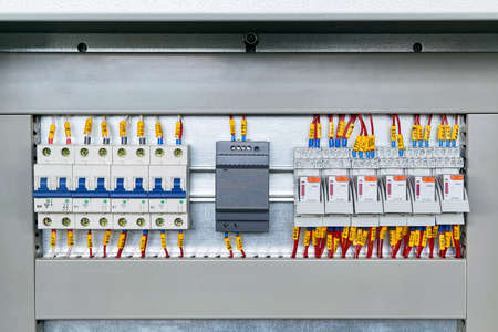 Several electrical circuit breakers, power supply and intermediate relays. Modern and reliable equipment in the electrical Cabinet. Connection of marked wires or cables.