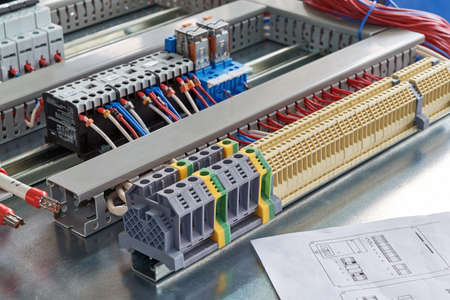 Terminals, contactors, relays, circuit breakers and electrical cabinet drawing, modern technologies concept Banco de Imagens