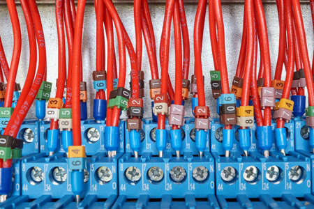 Many electrical wires are connected to intermediate relays. Wires and cables are marked with numbers. Relays switch electrical equipment automatically according to the scheme, project.