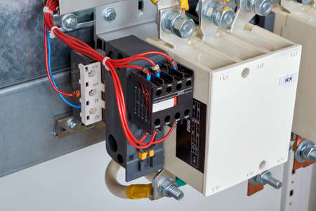 The electrical wires are connected to the side additional contacts of a powerful contactor or magnetic starter in the electrical Cabinet. Automation and uninterrupted power supply.