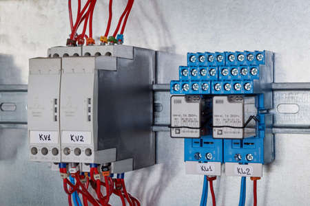 Two phase change control relays and two intermediate relays in the electrical Cabinet. Automation and remote control and distribution of electricity. Professional and reliable electrical equipment.
