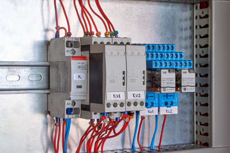 Modular contactor, phase control relay and intermediate relays in electrical Cabinet. Automation and remote control and distribution of electricity. Professional and reliable electrical equipment.