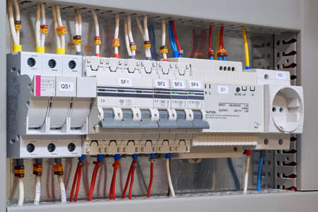 Fuse holder and breaker, circuit breakers, power supply and socket in the electrical Cabinet. Marked wires and cables are connected to electrical equipment. Protection of the electrical network.