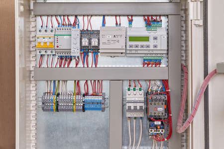 Control relay with screen, power supply, contactor or starter with thermal relay, circuit breakers, terminals, phase and voltage monitoring relays, intermediate relays in the electrical Cabinet.