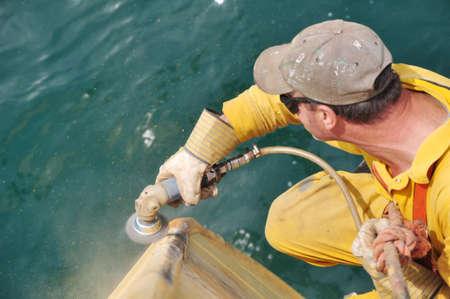 wire brushing of ship's hull Stock Photo - 5186716