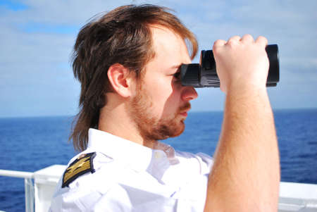 navigator on the watch on bridge of chemical tanker photo