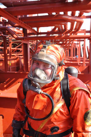 man in chemical suit on deck of chemical tanker photo