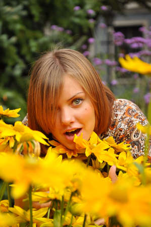 young pretty woman and flowers Stock Photo - 5427241