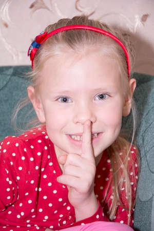 little finger: Beautiful girl asking for silence
