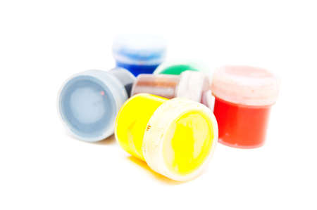 containers with paint on white background