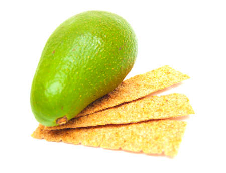 crackers and avocado isolated on white