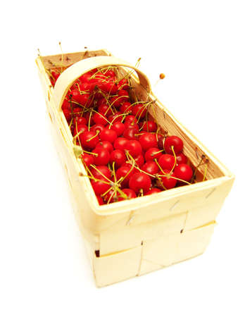 Cherry in the basket isolated on white background