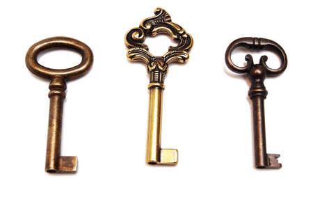 old-fashioned keys isolated on white