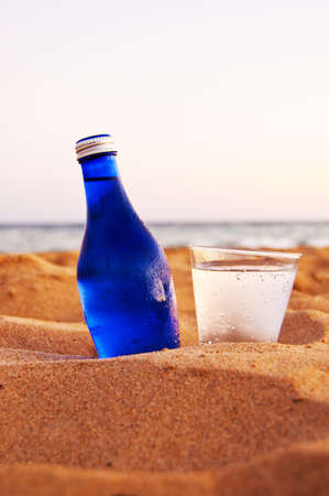 bottle and glass with cold soda on the beach Stock Photo - 7758803