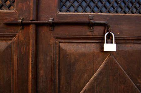 door closed on padlock ant bar