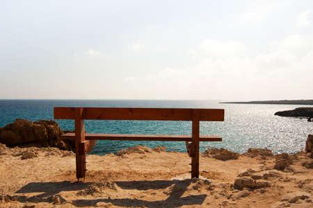 alone bench near the sea in cape greco photo