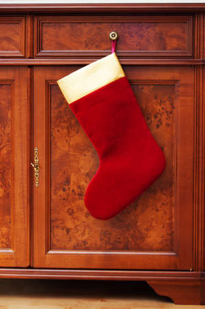christmas sock hanging on the cabinet photo