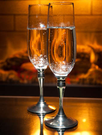 two glasses of champagne in front of fireplace Stock Photo - 8206155