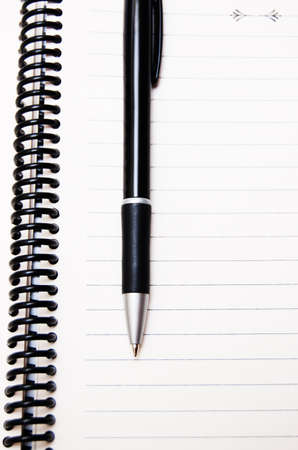 stripped notepad with pen Stock Photo