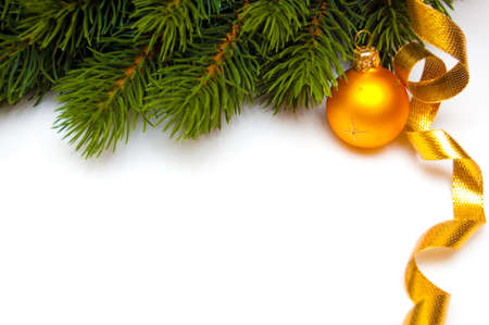 pine branch and christmas decoration on white background