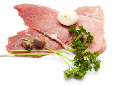 Several pieces of meat with garlic isolated on white