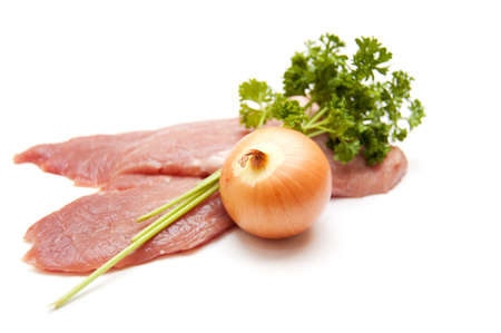 Several pieces of meat with onion isolated on white