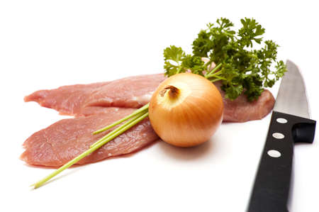 Several pieces of meat with knife isolated on white