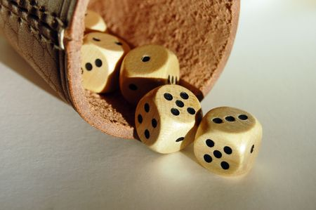 leathery: Throwing dices on the white table with the brown leathery dice-box