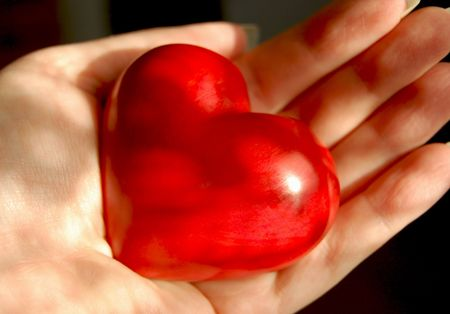 Red wooden heart on woman's palm Stock Photo - 2317776