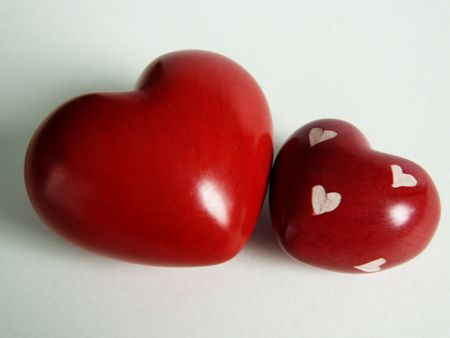 admire: Two wooden hearts on a white background Stock Photo