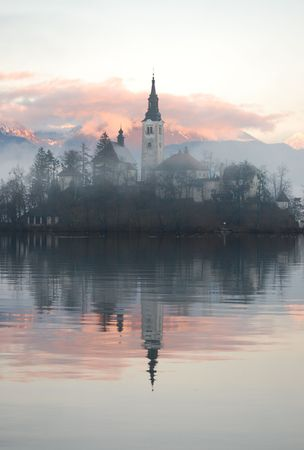 foggy hill: Foggy evening at the Bled lake Stock Photo