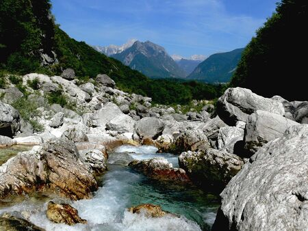 The stream running through the rocks with mountains in the background Stock Photo - 2530073