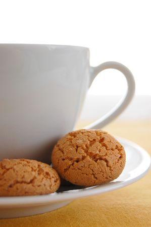 afternoon break: Closeup of a cup of tea or coffee with cookies on the plate